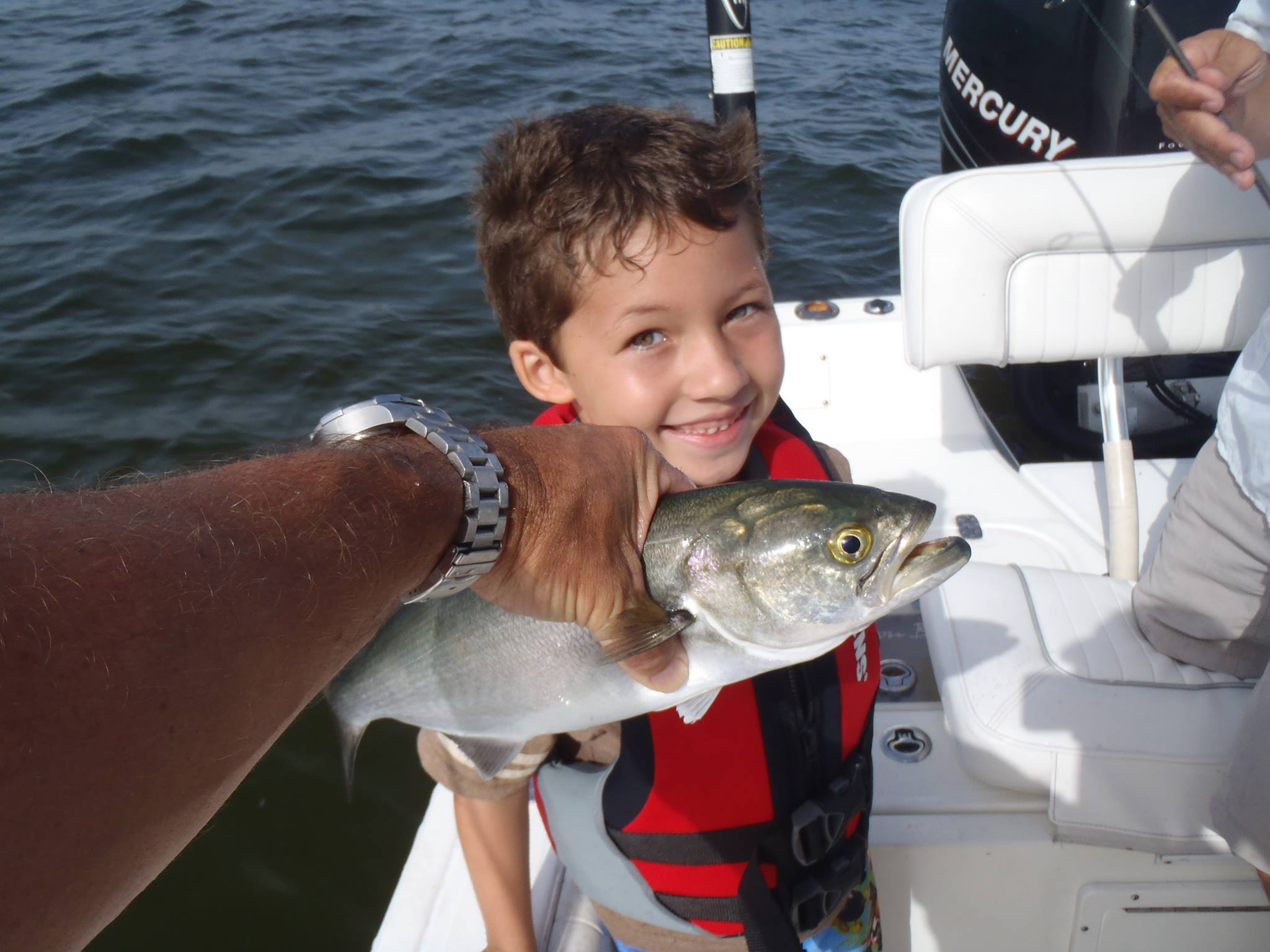 inshore fishing with boy and trout