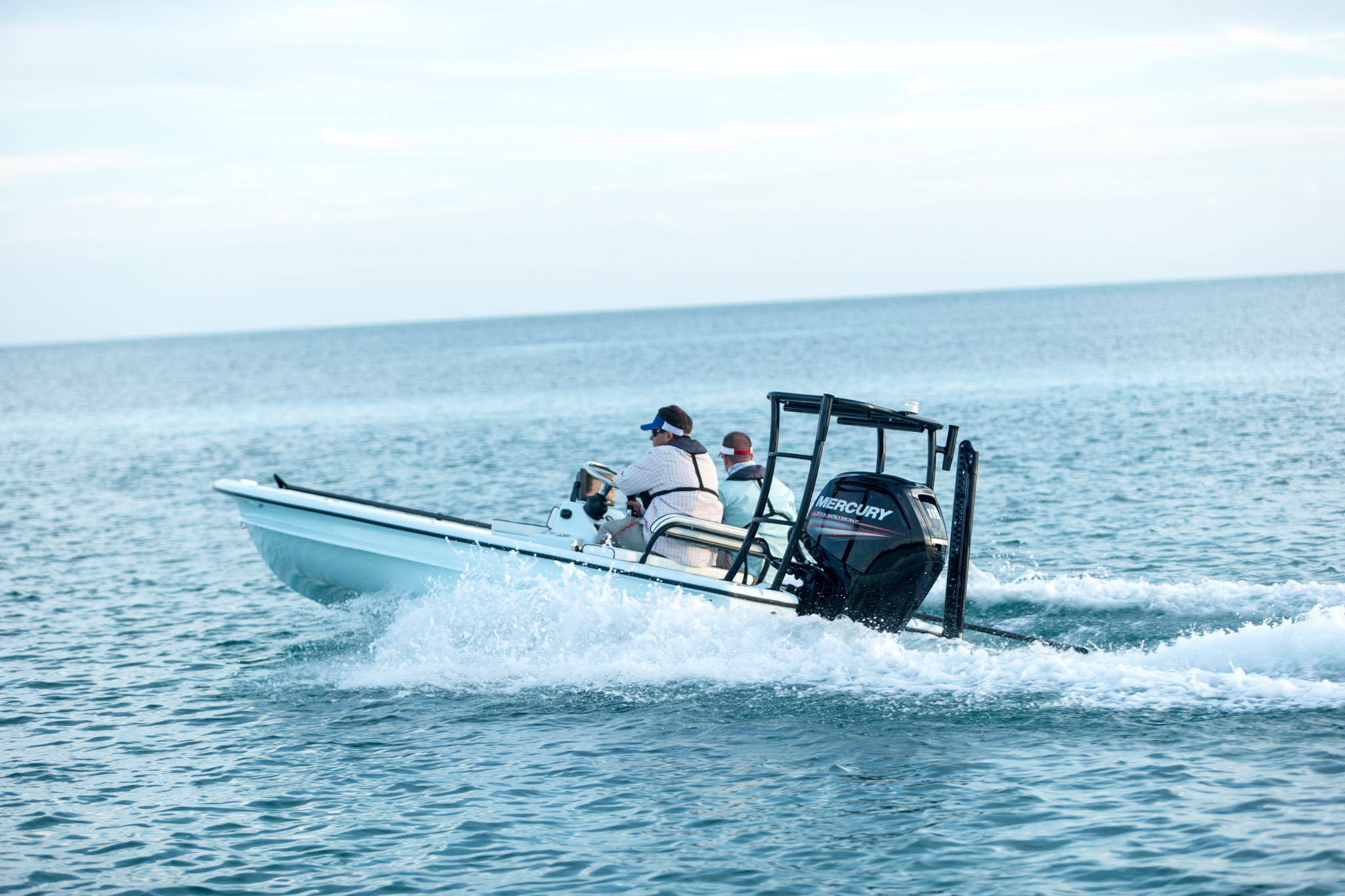 shallow water skiff with Mercury outboard